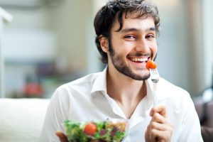 man eating healthy salad
