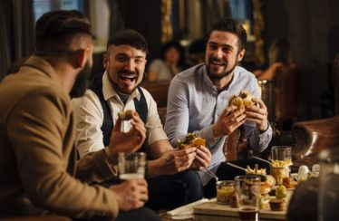 male friends having a great time in pub