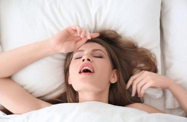 woman having orgasm in bed