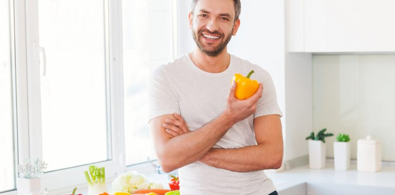 healthy man who takes Progentra eating healthy food