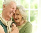 elderly couple laughing and happy with Progentra