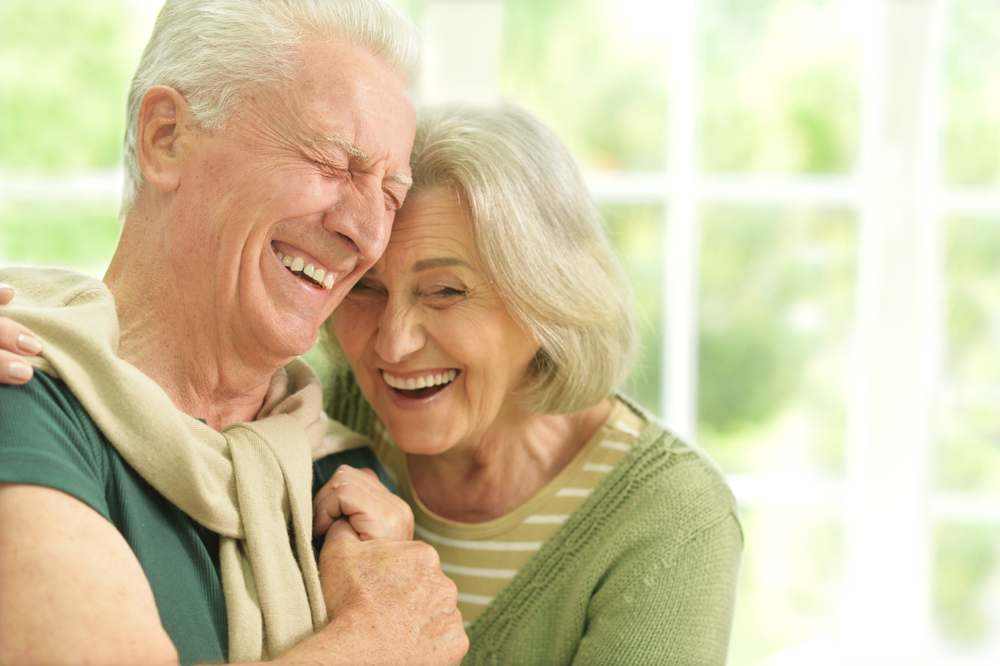 elderly couple laughing and happy