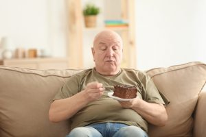 obese senior man eating cake should read about Progentra