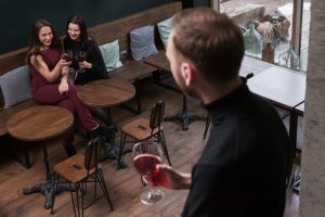 man checking out girl in bar more confident