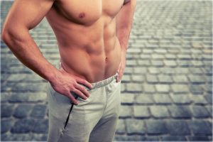 ripped shirtless man showing six pack abs