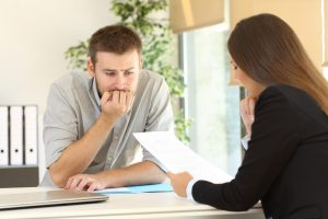 man nervously waiting for colleague's reaction on his work