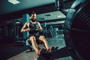 man doing intense cable row workout