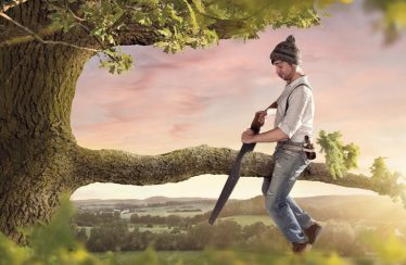man sawing off tree branch he is sitting on self sabotage