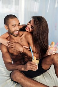 couple drinking cocktails in bed