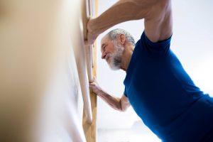 senior man wall push up