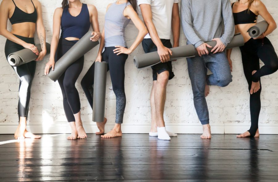 group of yogis with mat